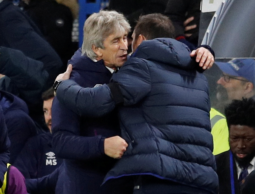 Pellegrini gets support from team after Chelsea win